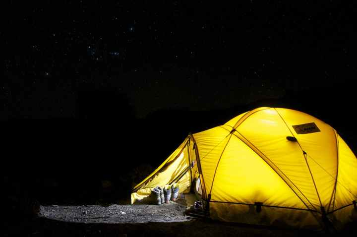 yellow tent under starry night